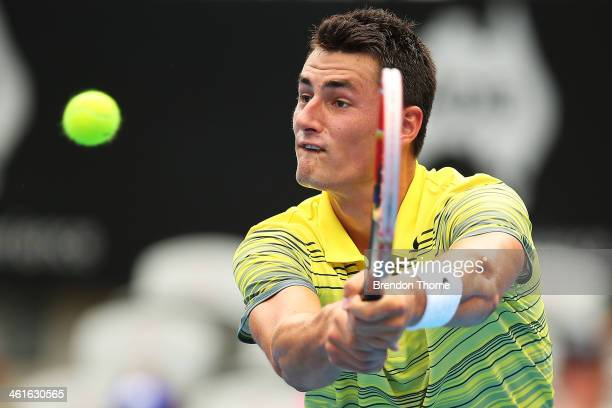 Bernard Tomic of Australia plays a backhand in his semi final match against Sergiy Stakhovsky of the Ukraine during day six of the Sydney...