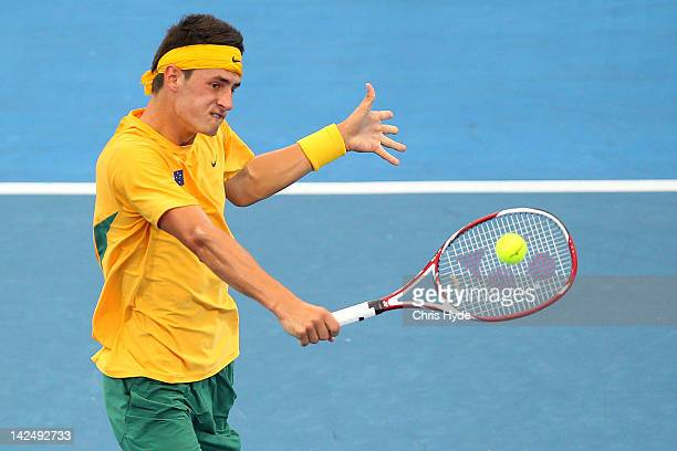 Bernard Tomic of Australia plays a backhand in his singles match against MinHyeok Cho of Korea on day one of the Davis Cup Asia Oceania Zone Second...