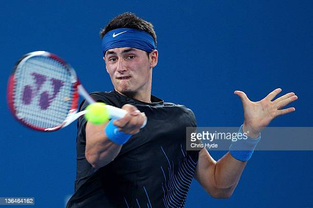 Bernard Tomic of Australia plays a forehand against Denis Istomin of Uzbekistan in their quarter final match during day six of the 2012 Brisbane...