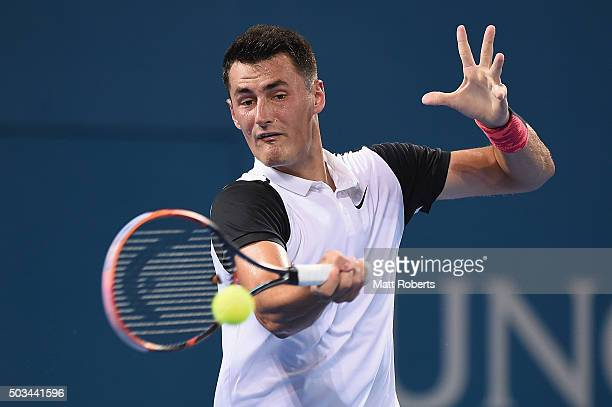 Bernard Tomic of Australia plays a forehand against Nicolas Mahut of France during day three of the 2016 Brisbane International at Pat Rafter Arena...