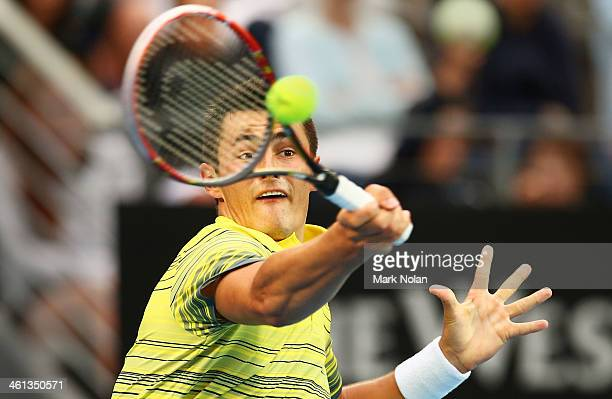 Bernard Tomic of Australia plays a forehand during his match against Blaz Kavcic of Slovenia during day four of the 2014 Sydney International at...