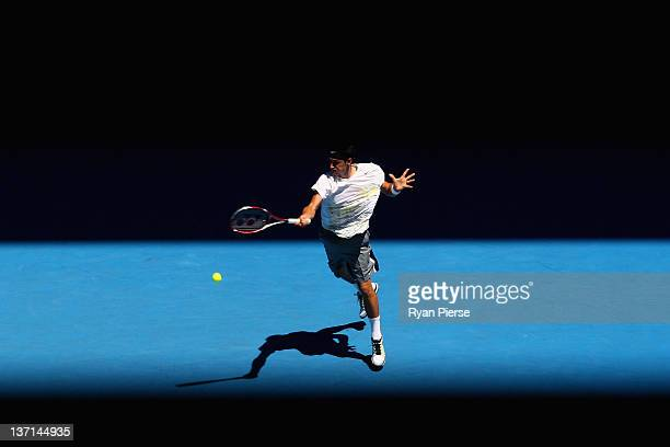 Bernard Tomic of Australia plays a forehand in his first round match against Fernando Verdasco of Spain during day one of the 2012 Australian Open at...