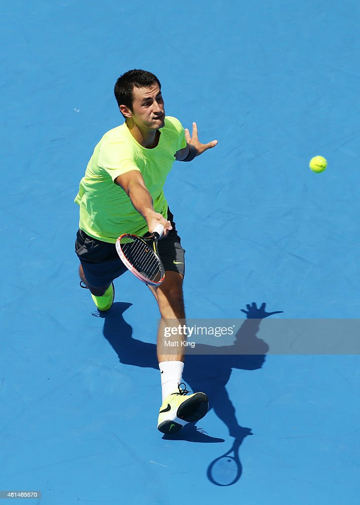 Bernard Tomic of Australia plays a forehand in his match against Igor Sijsling of the Netherlands during day three of the Sydney International at Sydney Olympic Park Tennis Centre on January 13, 2015 in Sydney, Australia.