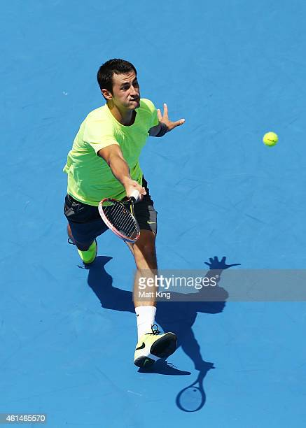 Bernard Tomic of Australia plays a forehand in his match against Igor Sijsling of the Netherlands during day three of the Sydney International at...