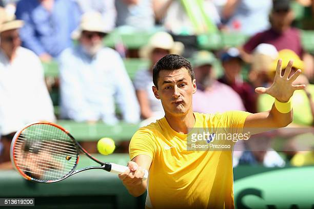 Bernard Tomic of Australia plays a forehand in his match against Jack Sock of the United States during the Davis Cup tie between Australia and the...