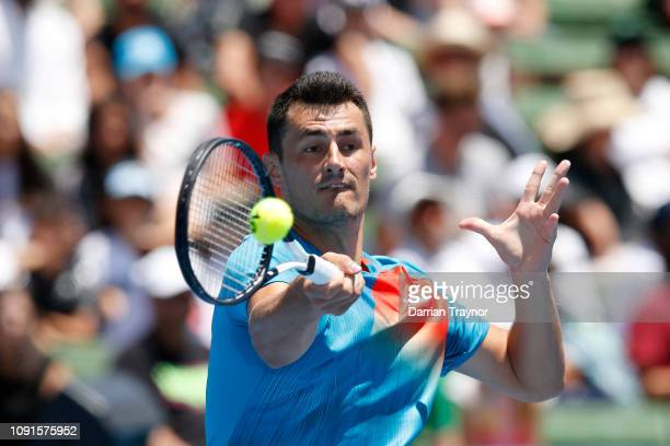 Bernard Tomic of Australia plays a forehand in his match against Nick Kyrgios of Australia during day two of the 2019 Kooyong Classic at the Kooyong...
