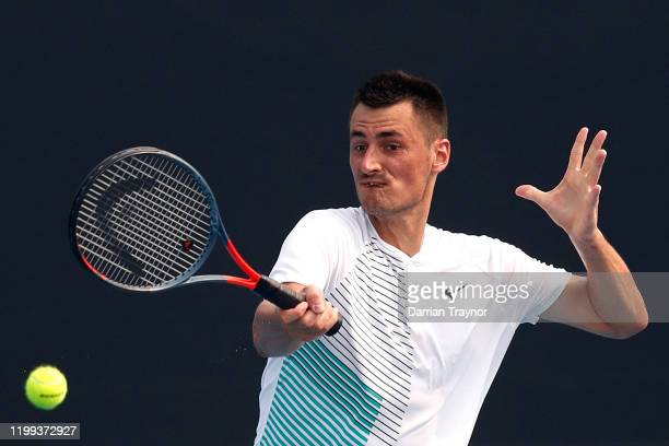 Bernard Tomic of Australia plays a forehand in his match against Denis Kudla of the United States during 2020 Australian Open Qualifying at Melbourne...