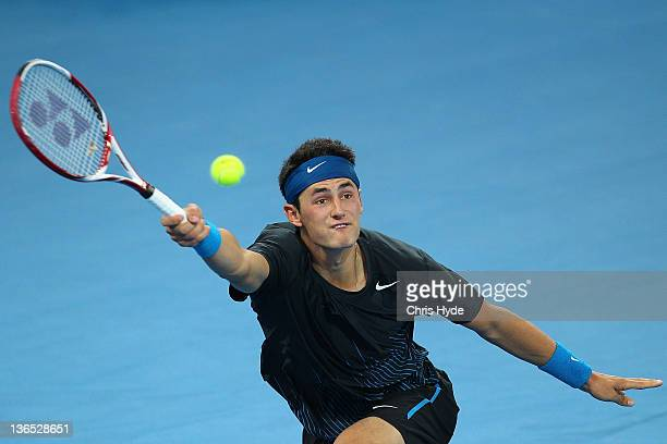 Bernard Tomic of Australia plays a forehand in his semi final match against Andy Murray of Great Britain during day seven of the 2012 Brisbane...