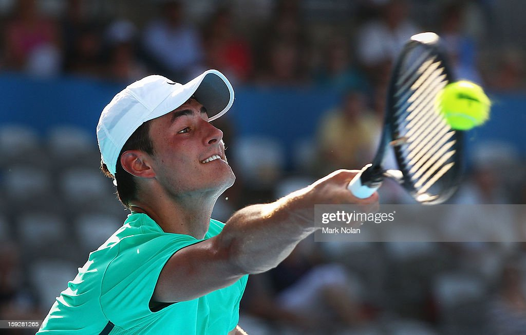 Bernard Tomic of Australia plays a forehand in his semi final match against Andreas Seppi of Italy during day six of the Sydney International at Sydney Olympic Park Tennis Centre on January 11, 2013 in Sydney, Australia.