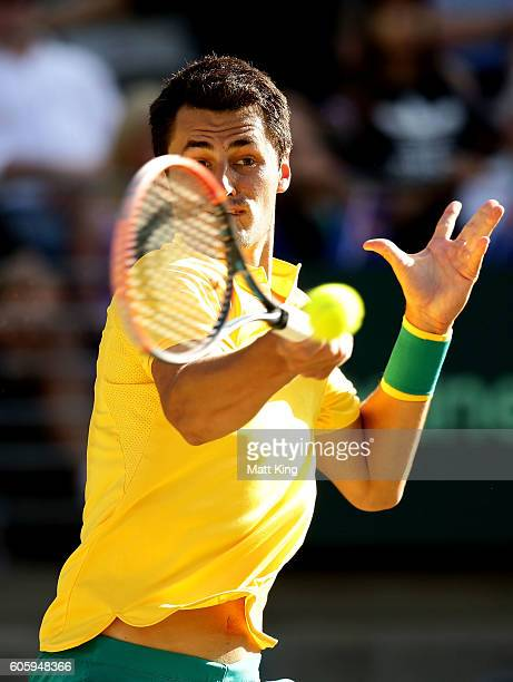 Bernard Tomic of Australia plays a forehand in his singles match against Jozef Kovalik of Slovakia during the Davis Cup World Group playoff between...