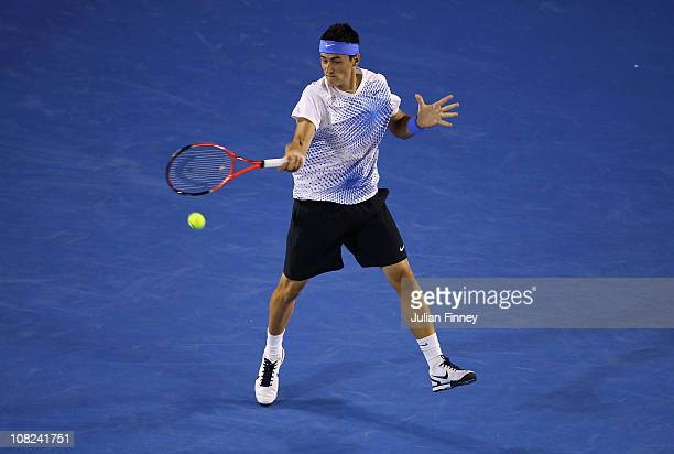 Bernard Tomic of Australia plays a forehand in his third round match against Rafael Nadal of Spain during day six of the 2011 Australian Open at...