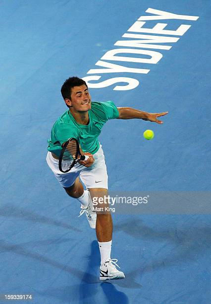 Bernard Tomic of Australia plays a forehand in the men's final match against Kevin Anderson of South Africa during day seven of the Sydney...