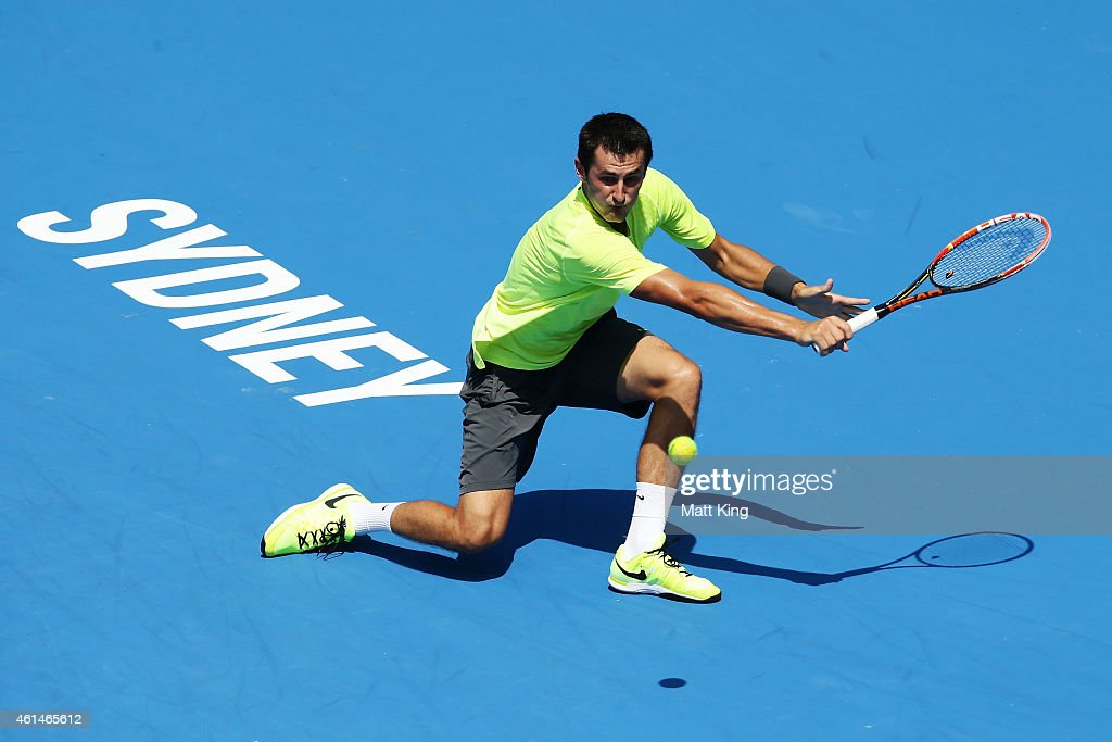 Bernard Tomic of Australia plays a plays a backhand in his match against Igor Sijsling of the Netherlands during day three of the Sydney International at Sydney Olympic Park Tennis Centre on January 13, 2015 in Sydney, Australia.