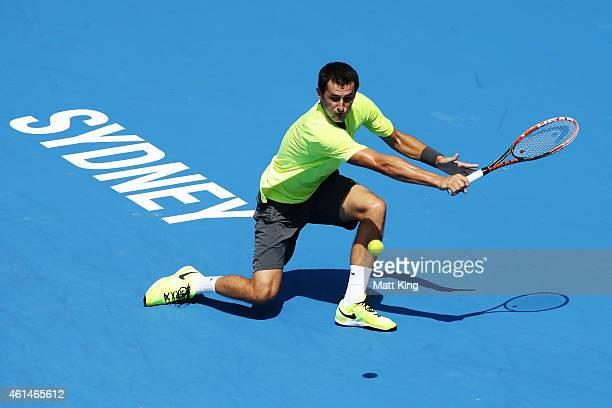 Bernard Tomic of Australia plays a plays a backhand in his match against Igor Sijsling of the Netherlands during day three of the Sydney...
