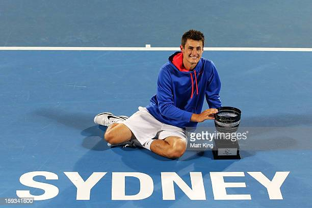 Bernard Tomic of Australia poses with the champions trophy after winning the men's final match against Kevin Anderson of South Africa during day...