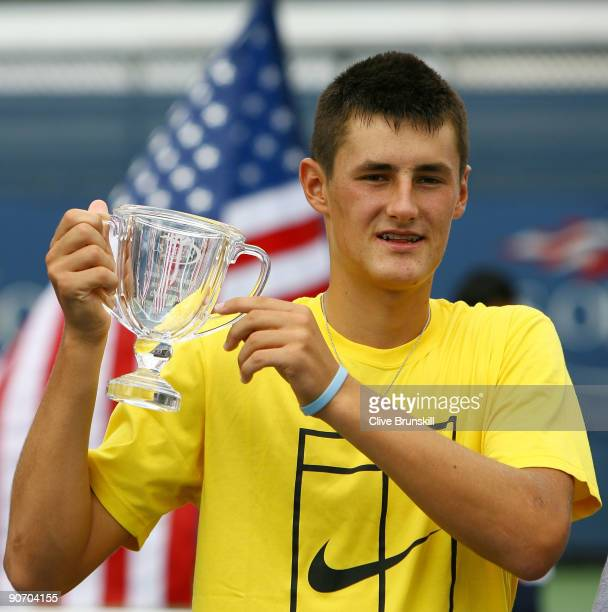 Bernard Tomic of Australia poses with the championship trophy after defeating Chase Buchanan in the Junior Boys' Singles final on day fourteen of the...