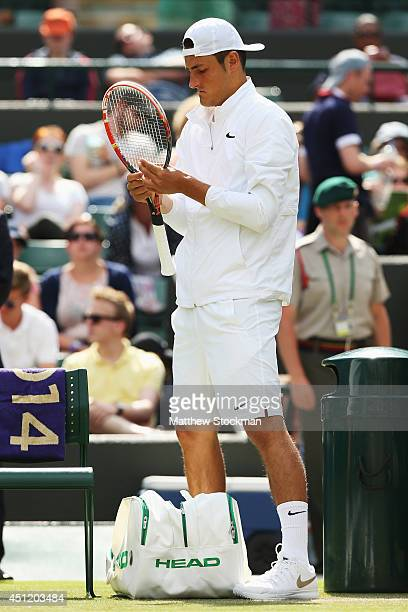 Bernard Tomic of Australia prepare for the start of his Gentlemen's Singles second round match against Tomas Berdych of Czech Republic on day three...