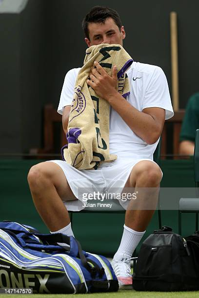 Bernard Tomic of Australia reacts after losing his Gentlemen's Singles first round match against David Goffin of Belgium on day two of the Wimbledon...