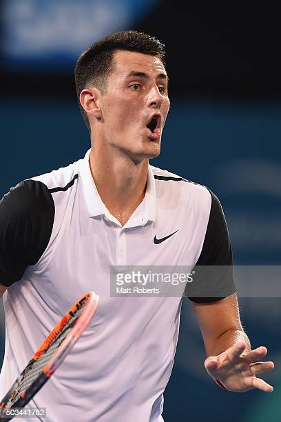 Bernard Tomic of Australia reacts in his match against Nicolas Mahut of France during day three of the 2016 Brisbane International at Pat Rafter...