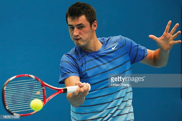 Bernard Tomic of Australia returns a ball to Zhang Ze of China on day three of the 2013 China Open at National Tennis Center on September 30 2013 in...