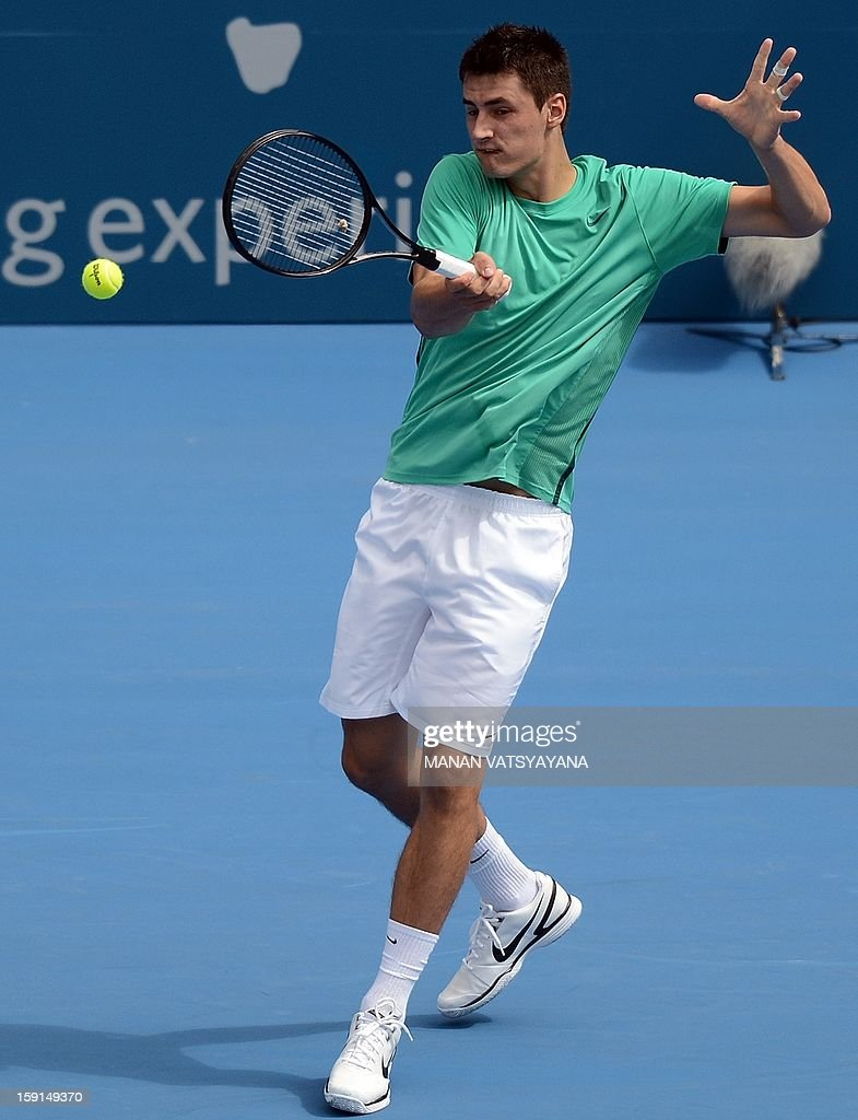 Bernard Tomic of Australia returns a shot against Florian Mayer of Germany during their second round match at the Sydney International tennis tournament on January 9, 2013.