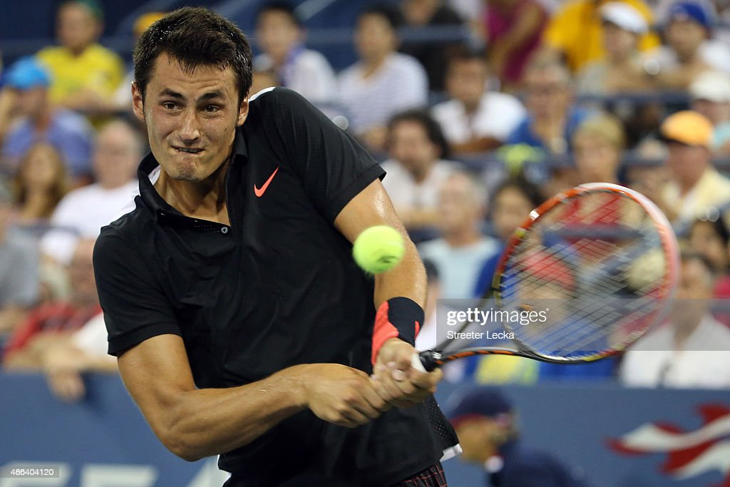 Bernard Tomic of Australia returns a shot against Lleyton Hewitt of Australia during their Men's Singles Second Round match on Day Four of the 2015 US Open at the USTA Billie Jean King National Tennis Center on September 3, 2015 in the Flushing neighborhood of the Queens borough of New York City.