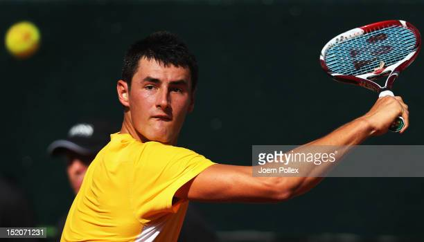 Bernard Tomic of Australia returns the ball to Florian Mayer of Germany during the Davis Cup World Group Play-Off match between Germany and Australia...