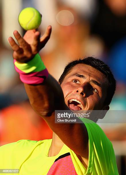 Bernard Tomic of Australia serves against Tomas Berdych of the Czech Republic in theiir third round match during the Miami Open Presented by Itau at...
