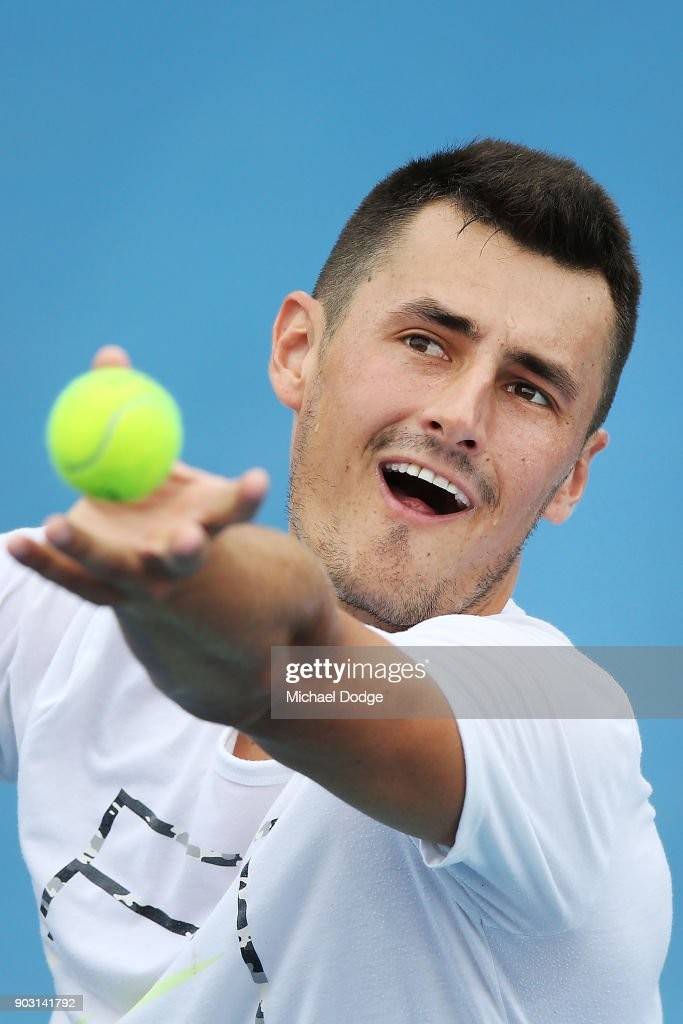 Bernard Tomic of Australia serves during a practice session ahead of the 2018 Australian Open at Melbourne Park on January 10, 2018 in Melbourne, Australia.