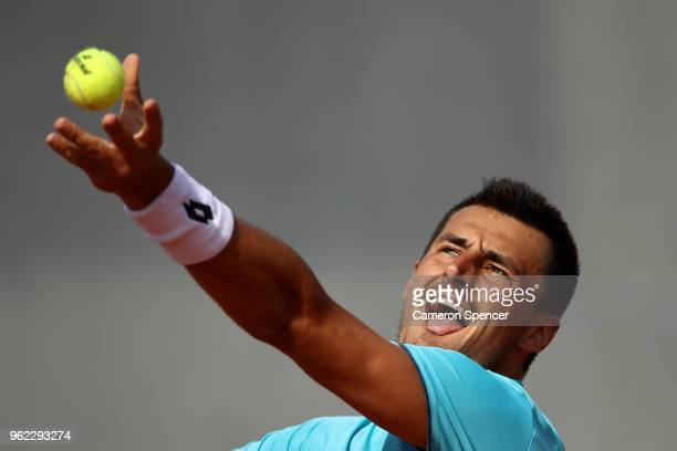Bernard Tomic of Australia serves during his French Open third round menÕs qualifying singles match against Goncalo Oliveira of Portugal at Roland...