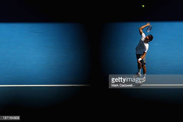 Bernard Tomic of Australia serves during his round one match against Fernando Verdasco of Spainduring day one of the 2012 Australian Open at...