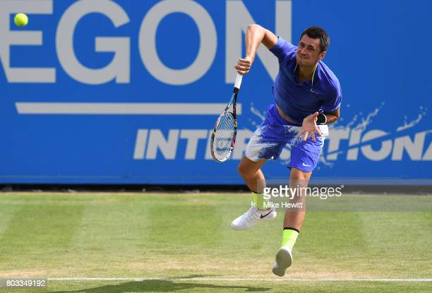 Bernard Tomic of Australia serves during the men's singles quarter final match against Gael Monfils of France on day five of the Aegon International...