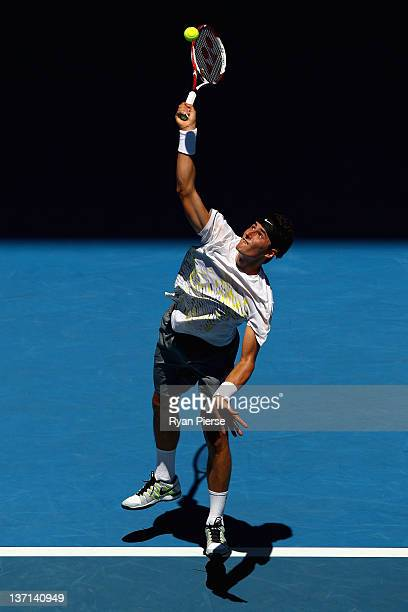 Bernard Tomic of Australia serves in his first round match against Fernando Verdasco of Spain during day one of the 2012 Australian Open at Melbourne...