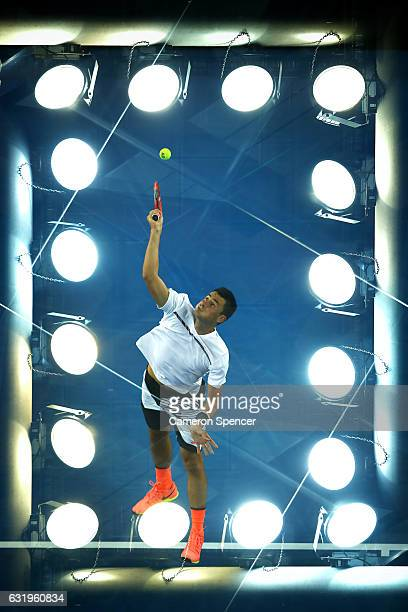 Bernard Tomic of Australia serves in his second round match against Victor Estrella Burgos of The Dominican Republic on day three of the 2017...
