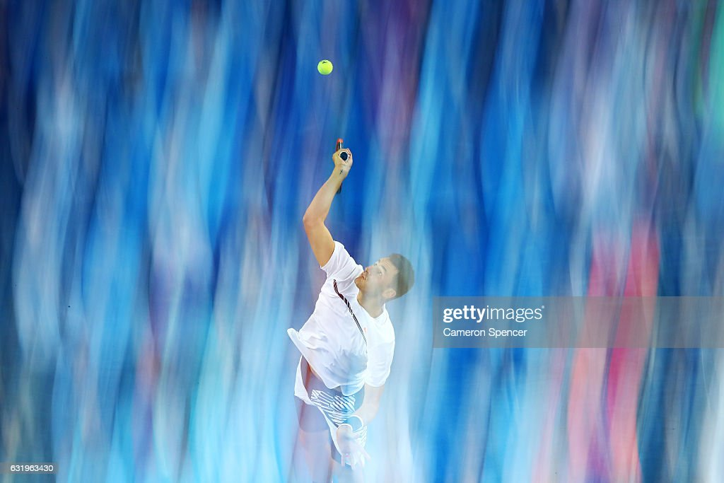 Bernard Tomic of Australia serves in his second round match against Victor Estrella Burgos of The Dominican Republic on day three of the 2017 Australian Open at Melbourne Park on January 18, 2017 in Melbourne, Australia.