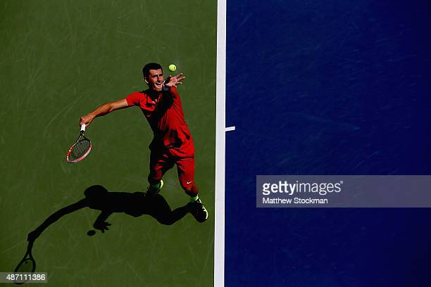 Bernard Tomic of Australia serves to Richard Gasquet of France during their Men's Singles Third Round match on Day Six of the 2015 US Open at the...