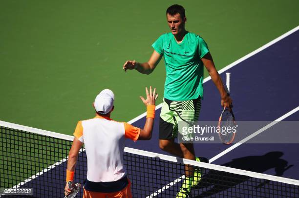 Bernard Tomic of Australia shakes hands at the net after his straight sets defeat against Bjorn Fratangelo of the United States in their first round...