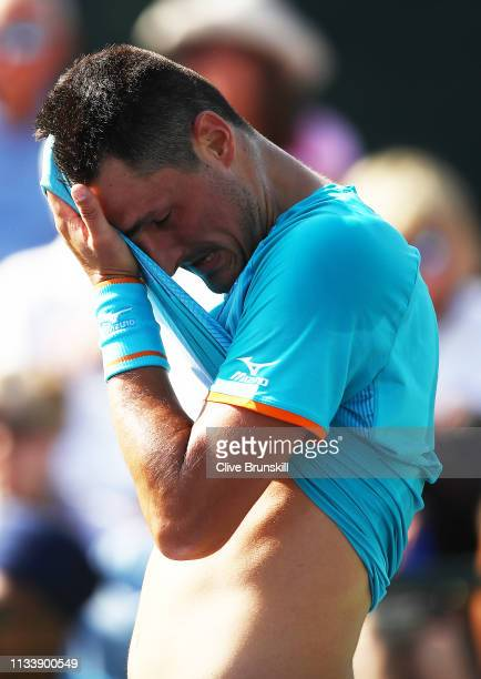 Bernard Tomic of Australia shows his frustration during his three set defeat to Lukas Rosol of the Czech Republic in their second round qualifying...