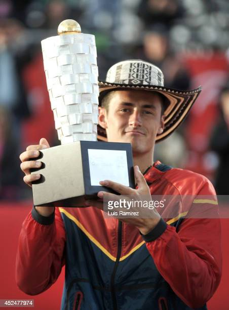 Bernard Tomic of Australia shows the champion trophy during a tennis match between Bernard Tomic of Australia and Ivo Karlovic of Croatia as part of...