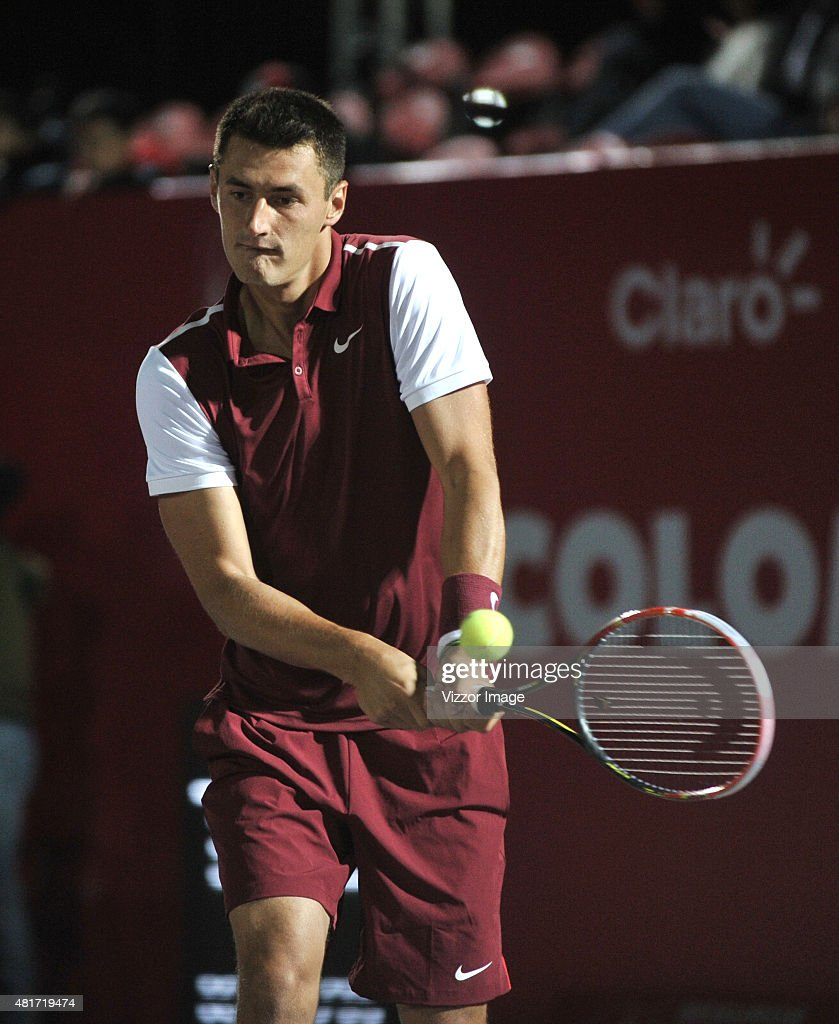 Bernard Tomic of Australia takes a backhand shot during a match between Adrian Menendez-Maceiras of Spain and Bernard Tomic of Australia as part of Claro Open Colombia 2015 at Centro de Alto Rendimiento on July 23, 2015 in Bogota, Colombia.