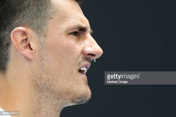 Bernard Tomic of Australia waits to receive during a practice session ahead of the 2018 Australian Open at Melbourne Park on January 10 2018 in...