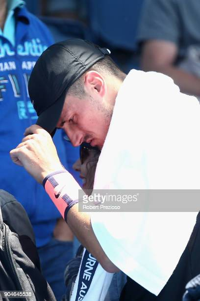 Bernard Tomic of Australia walks off after losing his third round match against Lorenzo Sonego of Italy during 2018 Australian Open Qualifying at...