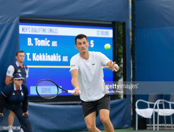 Bernard Tomic returns ball during qualifying day 1 against Thanasi Kokkinakis of Australia at US Open Tennis championship at USTA Billie Jean King...