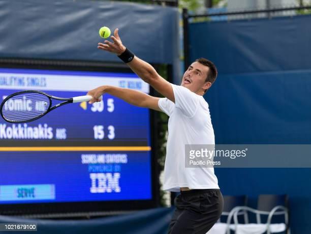 Bernard Tomic serves during qualifying day 1 against Thanasi Kokkinakis of Australia at US Open Tennis championship at USTA Billie Jean King National...
