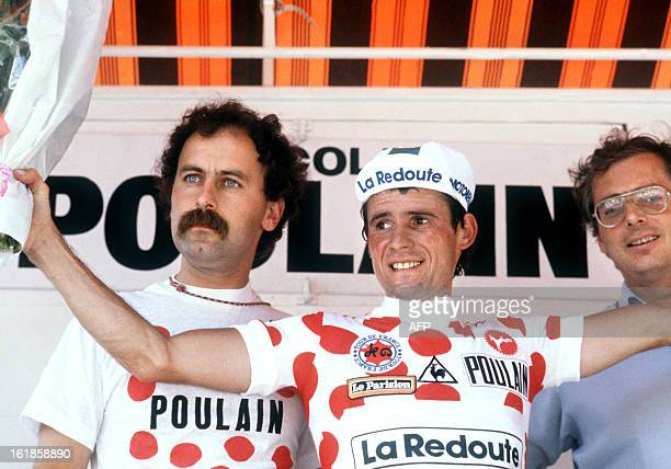 Bernard Vallet , wearing the red and white Polka Dot Jersey of the best climber, waves from podium 13 July 1982 at the end of the 13th stage of the...