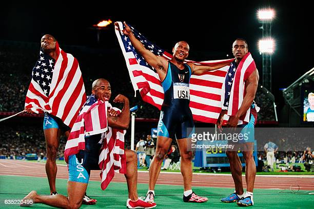 Bernard Williams III Brian Lewis Maurice Greene and Jon Drummond of the United States' team celebrates after winning the men's 4x100meters relay...