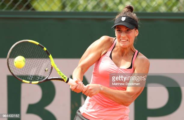 Bernarda Pera of The United States plays a backhand during the ladies singles second round match against Daria Gavrilova of Australia during day five...