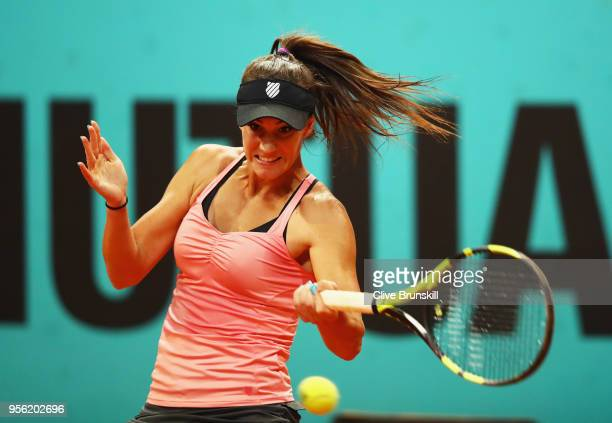 Bernarda Pera of the United States plays a forehand against Johanna Konta of Great Britain during day four of the Mutua Madrid Open tennis tournament...