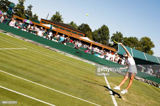 Bernarda Pera of the United States serves against Luksika Kumkhum of Thailand in the first round of the 2018 Wimbledon Championships at the All...