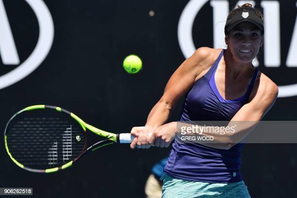 Bernarda Pera of the US hits a return during her women's singles second round match against Britain's Johanna Konta on day four of the Australian...